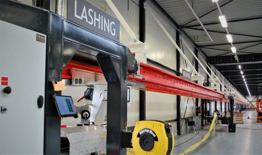 "alt=""lashing machine in production facility """