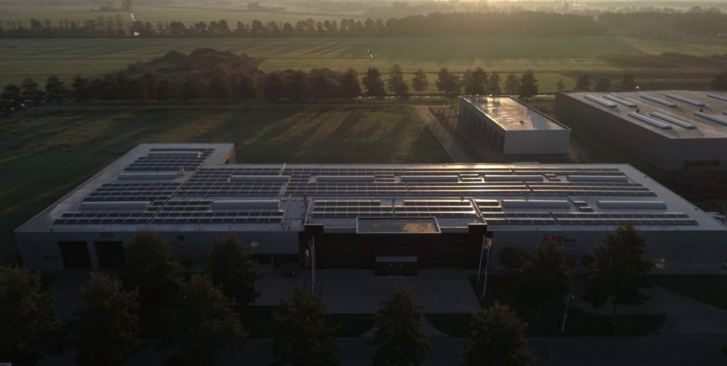 "alt=""prodcution facility with solar panels"""
